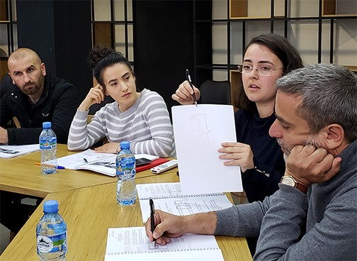 Staff from the municipal workers department responsible for the maintenance of school grounds give feedback about typical surface drainage systems